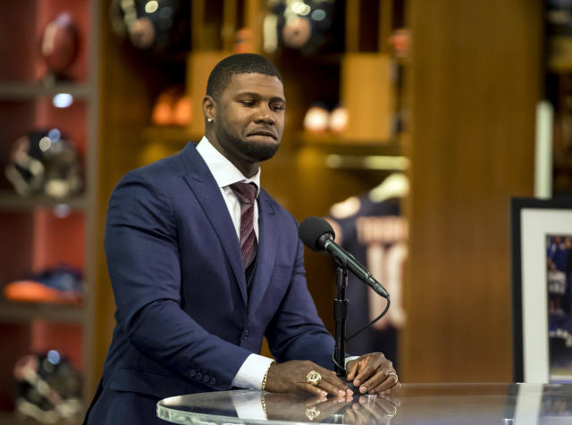 Former Chicago Bears returner Devin Hester speaks during a retirement ceremony Monday, April 23, 2018 at Halas Hall. Hester hopes to get into the Hall of Fame some day but may soon be part of an extinct breed if the NFL eliminates kick returns as is being suggested. Hester and former Bears multipurpose back Matt Forte officially retired Monday at an emotional ceremony after signing one-day contracts with their first NFL team. (Brian Cassella/Chicago Tribune via AP)