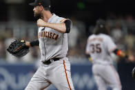 San Francisco Giants first baseman Brandon Belt, left, reacts after the Giants defeat the San Diego Padres 6-5 in a baseball game Tuesday, Sept. 21, 2021, in San Diego. (AP Photo/Gregory Bull)