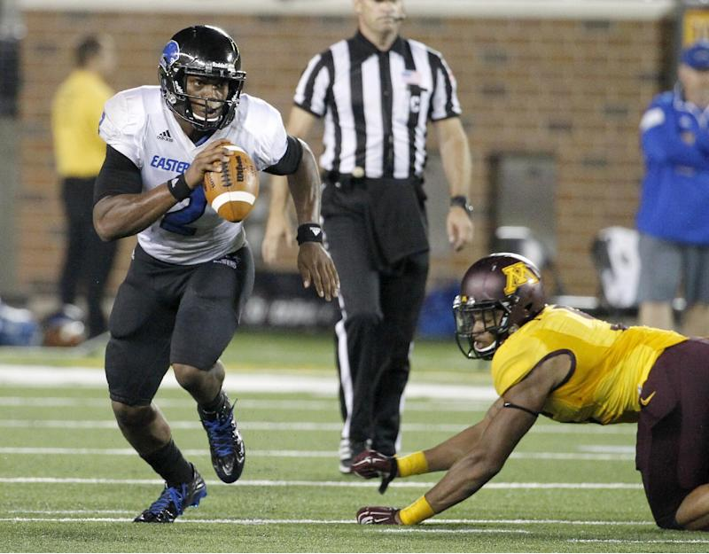 Eastern Illinois quarterback Jalen Whitlow, left, leaves behind Minnesota linebacker Damien Wilson, right, on a nine-yard gain during the third quarter of an NCAA college football game in Minneapolis Thursday, Aug. 28, 2014. Minnesota won 42-20