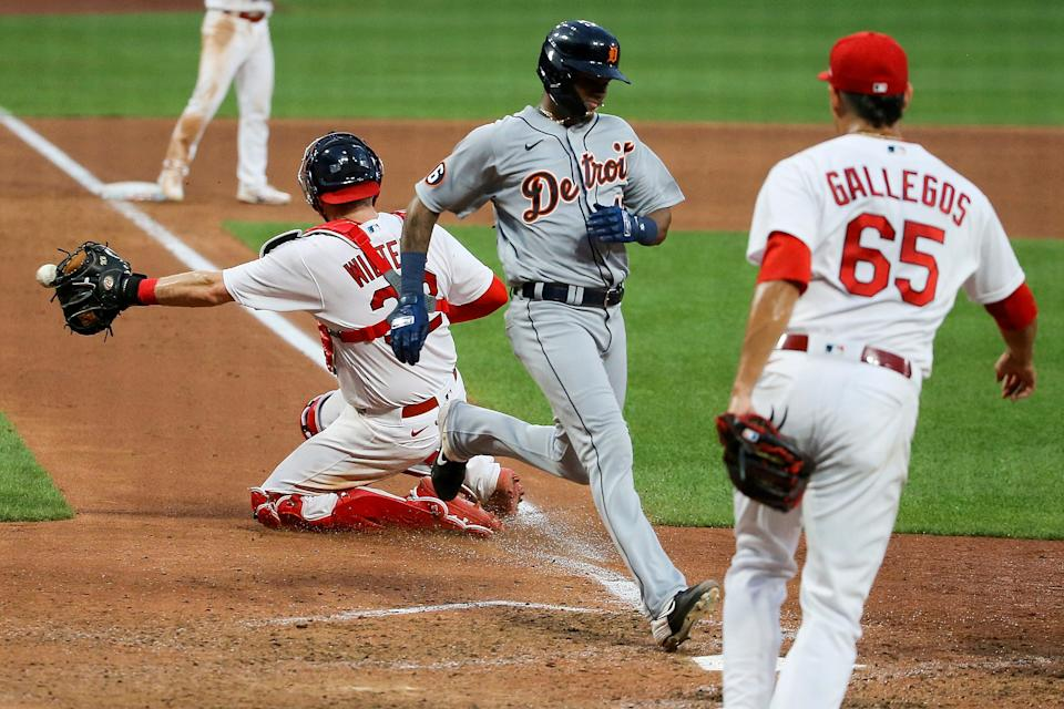 Tigers third baseman Sergio Alcantara scores as Cardinals relief pitcher Giovanny Gallegos backs up the throw to Cardinals catcher Matt Wieters during the seventh inning of the Tigers' 6-3 win in the second game of the doubleheader on Thursday, Sept. 10, 2020, in St. Louis.