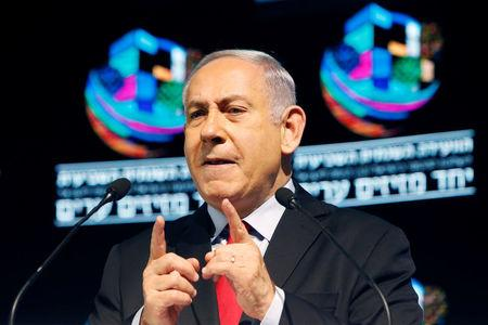 Israeli Prime Minister Benjamin Netanyahu speaks during the Muni World 2018 conference in Tel Aviv