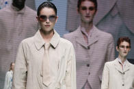 Models wear creations for the Emporio Armani Spring Summer 2022 collection during Milan Fashion Week, in Milan, Italy, Thursday, Sept. 23, 2021. (AP Photo/Luca Bruno)