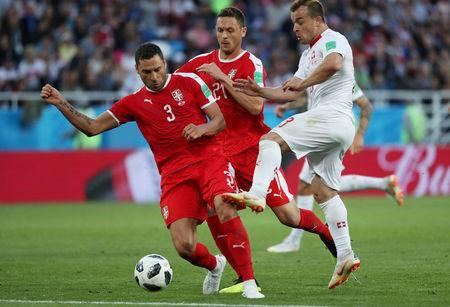 Soccer Football - World Cup - Group E - Serbia vs Switzerland - Kaliningrad Stadium, Kaliningrad, Russia - June 22, 2018 Serbia's Dusko Tosic and Nemanja Matic in action with Switzerland's Xherdan Shaqiri REUTERS/Ricardo Moraes