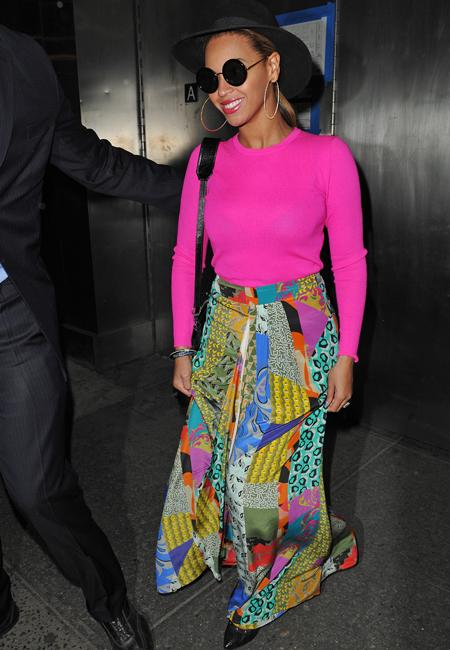 Celebrity fashion: Beyonce isn't fearful of bright fashion! She's one of the few celebs who can pull of such a look and she does so with aplomb. Clad in a Michael Kors pink sweater with an abstract-print skirt by Etro she's ready for summer!