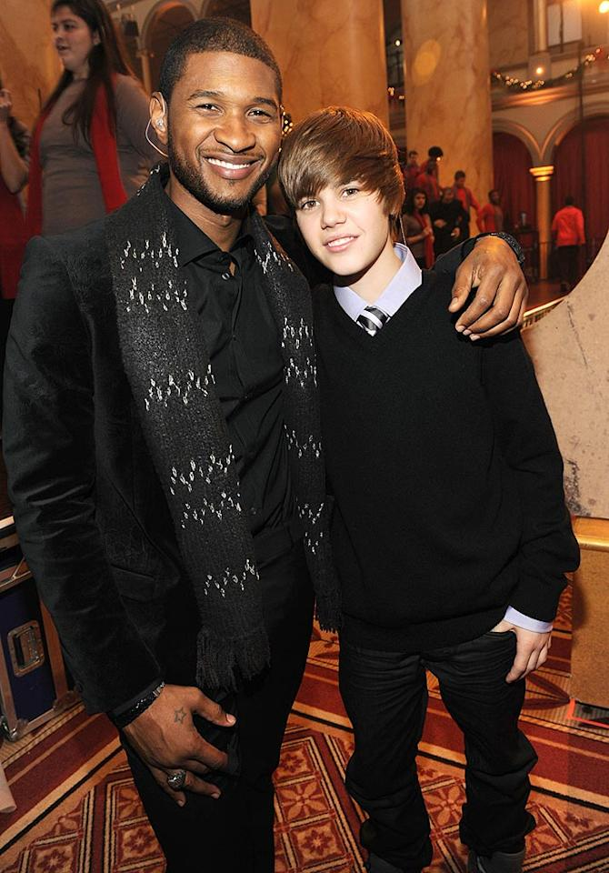 "Usher poses with his protege, Justin Bieber, at the ""Christmas in Washington"" holiday concert held at the National Building Museum in Washington, DC. The 15-year-old YouTube sensation was proud to sing Stevie Wonder's ""Someday at Christmas"" for President Obama and first lady Michelle Obama. Kevin Mazur/<a href=""http://www.wireimage.com"" target=""new"">WireImage.com</a> - December 13, 2009"