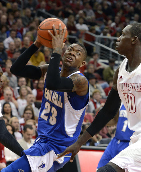 Seton Hall's Fuquan Edwin, left, drives to the basket past the defense of Louisville's Gorgui Dieng during the first half of an NCAA college basketball game Saturday Feb. 23, 2013 in Louisville, Ky. (AP Photo/Timothy D. Easley)