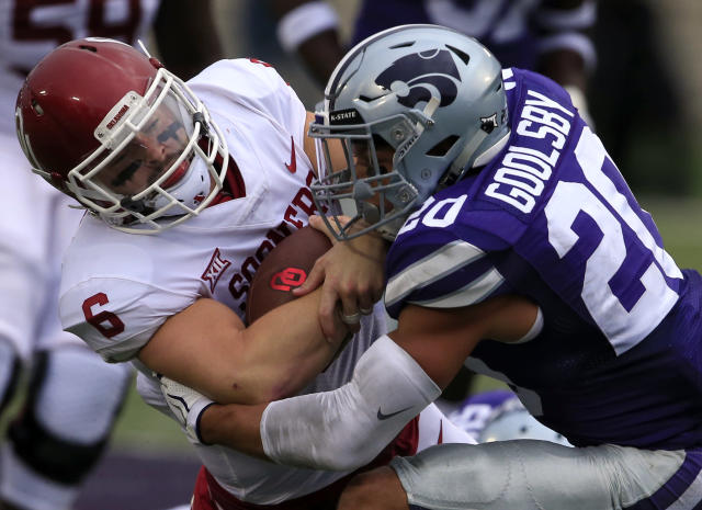 "Oklahoma quarterback <a class=""link rapid-noclick-resp"" href=""/ncaaf/players/229650/"" data-ylk=""slk:Baker Mayfield"">Baker Mayfield</a> (6) is tackled by Kansas State defensive back <a class=""link rapid-noclick-resp"" href=""/ncaaf/players/255159/"" data-ylk=""slk:Denzel Goolsby"">Denzel Goolsby</a> (20) during the first half of an NCAA college football game in Manhattan, Kan., Saturday, Oct. 21, 2017. (AP Photo/Orlin Wagner)"