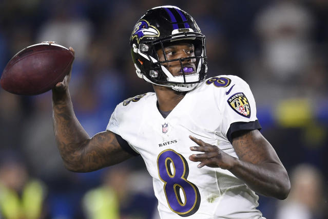 FILE - In this Dec. 22, 2018 file photo, Baltimore Ravens quarterback Lamar Jackson passes against the Los Angeles Chargers during the first half in an NFL football game in Carson, Calif. The Ravens won last year behind the arm, and mostly legs, of rookie quarterback Lamar Jackson. (AP Photo/Kelvin Kuo, File)