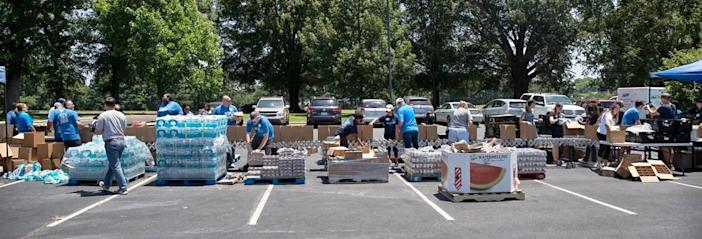 Volunteers gathered to pack 1,000 Emergency Preparedness Kits filled with food, water and other supplies to disburse to families and individuals in case of a flood or hurricane on June 18, 2021 at the Inter-faith Food Shuttle warehouse in Raleigh, N.C. The Food Shuttle, along with volunteers from Blue Cross NC and Food Lion collaborated to pack the kits.