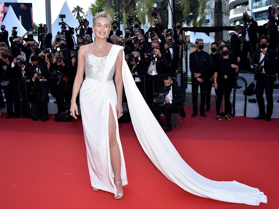 """Sharon Stone wears a white dress while at the """"OSS 117: From Africa With Love"""" Final Screeing & Closing Ceremony Red Carpet."""