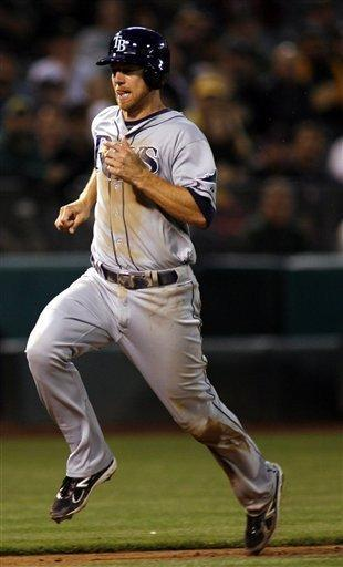 Tampa Bay Rays' Ben Zobrist scores against the Oakland Athletics in the sixth inning of a baseball game in Oakland, Calif., Tuesday, July 31, 2012. (AP Photo/Dino Vournas)