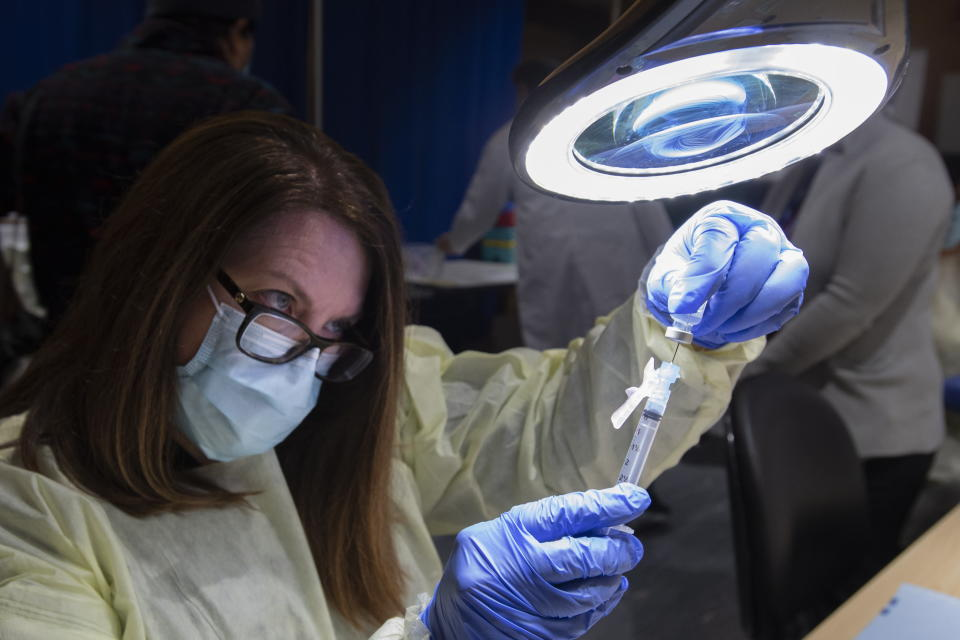 A dose of the Pfizer-BioNTech COVID-19 vaccine is prepared by Pharmacy Technician Supervisor Tamara Booth Rumsey at The Michener Institute in Toronto on Monday, Jan. 4, 2021. (Frank Gunn/The Canadian Press via AP)