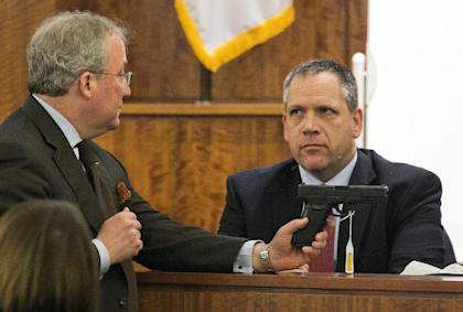 Prosecutor Patrick Bomberg, left, questions Kyle Aspinwall, an employee of weapons manufacturer Glock. (AP)