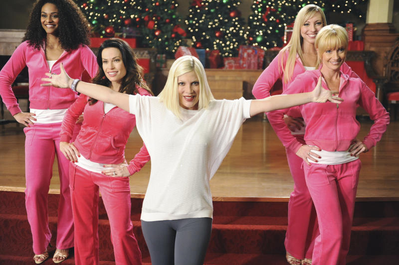 "This image released by ABC Family shows Tori Spelling, center, in a scene from the ABC Family original holiday musical, ""The Mistle-Tones,"" also starring Tia Mowry.  The special is part of the network's ""25 Days of Christmas""  Premiering Sunday, Dec. 9  at 8:00 p.m. EST. (AP Photo/ABC Family, Fred Hayes)"