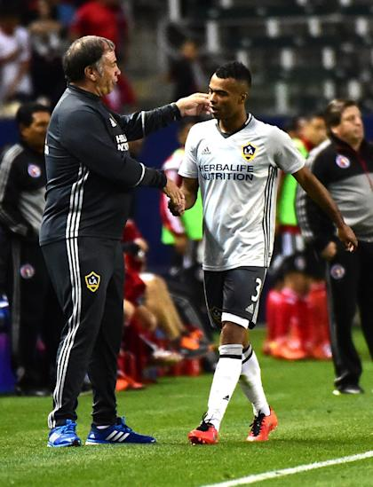 Ashley Cole #3 of Los Angeles Galaxy is greeted by coach Bruce Arena. (Photo by Harry How/Getty Images)