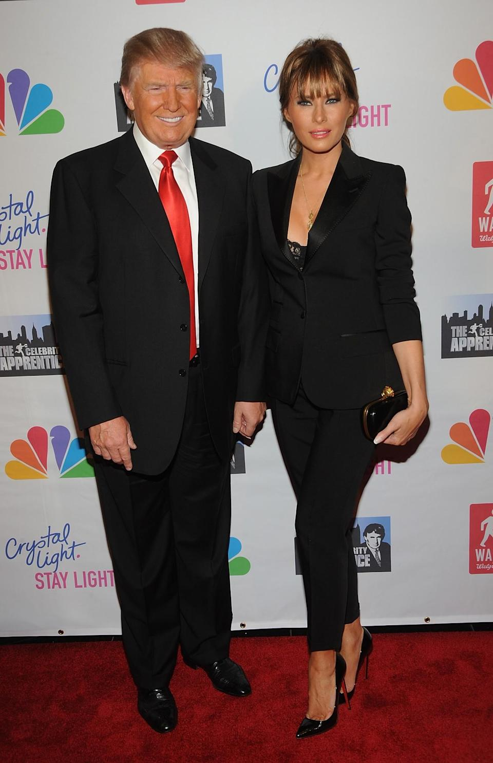 <p>For the live finale of <i>Celebrity Apprentice</i>, Melania fittingly chose a smart black suit, showing the hint of a lacy bra underneath. <i>[Photo: Getty]</i> </p>