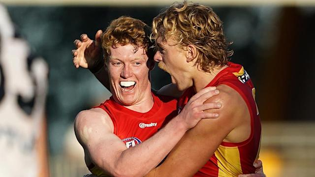 Matt Rowell (L) has shone again for in-form Gold Coast in their 53-point AFL thumping of Adelaide