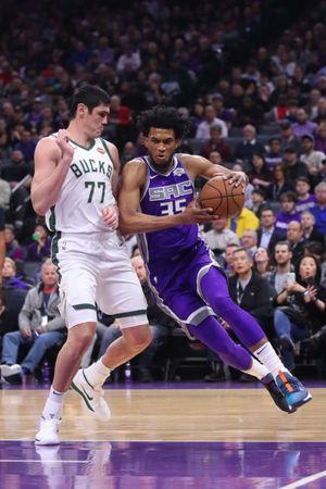 Feb 27, 2019; Sacramento, CA, USA; Sacramento Kings forward Marvin Bagley III (35) attempts to drive past Milwaukee Bucks forward Ersan Ilyasova (77) in the first quarter at the Golden 1 Center. Mandatory Credit: Cary Edmondson-USA TODAY Sports