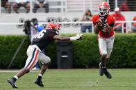 Georgia wide receiver Matt Landers (5) makes a catch as defensive back Lewis Cine (16) closes in during the first half in Georgia's spring NCAA college football game, Saturday, April 17, 2021, in Athens, Ga. (AP Photo/John Bazemore)