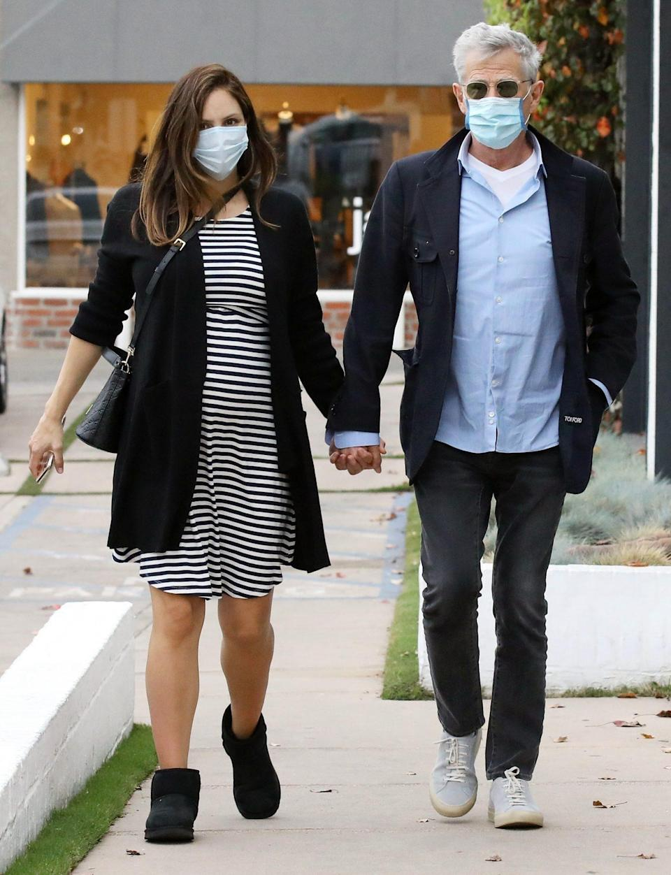 <p>Pregnant Katharine McPhee and David Foster walk hand-in-hand in West Hollywood on Monday.</p>