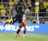 Columbus Crew forward Gyasi Zardes, left, heads the ball over New York Red Bulls defender John Tolkin during the first half of an MLS soccer match in Columbus, Ohio, Tuesday, Sept. 14, 2021. (AP Photo/Paul Vernon)