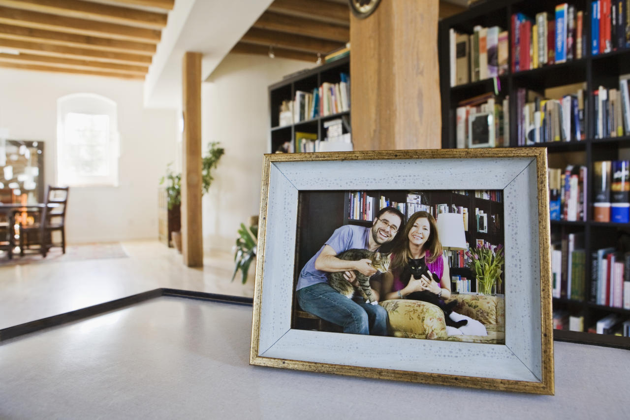 <p>Digital photo frames, mobile phones and social media mean people are missing printed photos decorating their homes. [Picture: Getty] </p>