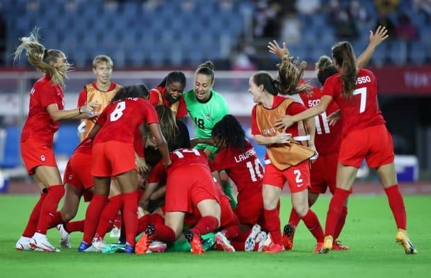 Team Canada celebrates after a thrilling women's soccer quarter-final win over Brazil in penalty kicks. (Koki Nagahama/Getty Images - image credit)