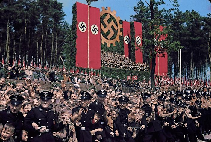 """Volkswagen Works cornerstone ceremony, near Wolfsburg, 1938. (Hugo Jaeger—Time & Life Pictures/Getty Images) <br> <br> <a href=""""http://life.time.com/world-war-ii/nazi-propaganda-and-the-myth-of-aryan-invincibility/#1"""" rel=""""nofollow noopener"""" target=""""_blank"""" data-ylk=""""slk:Click here to see the full collection at LIFE.com"""" class=""""link rapid-noclick-resp"""">Click here to see the full collection at LIFE.com</a>"""