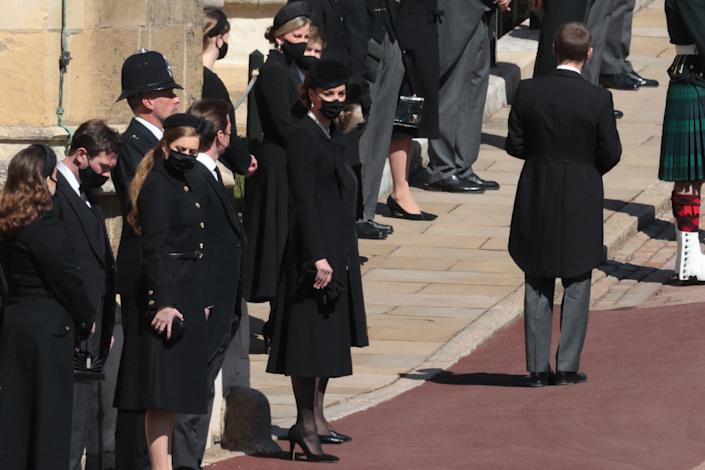 Britain's Catherine, Duchess of Cambridge (R) and members of the Royal family stand outside St George's Chapel for the funeral service of Britain's Prince Philip, Duke of Edinburgh in Windsor Castle in Windsor, west of London, on April 17, 2021. - Philip, who was married to Queen Elizabeth II for 73 years, died on April 9 aged 99 just weeks after a month-long stay in hospital for treatment to a heart condition and an infection. (Photo by HANNAH MCKAY / various sources / AFP) (Photo by HANNAH MCKAY/AFP via Getty Images)