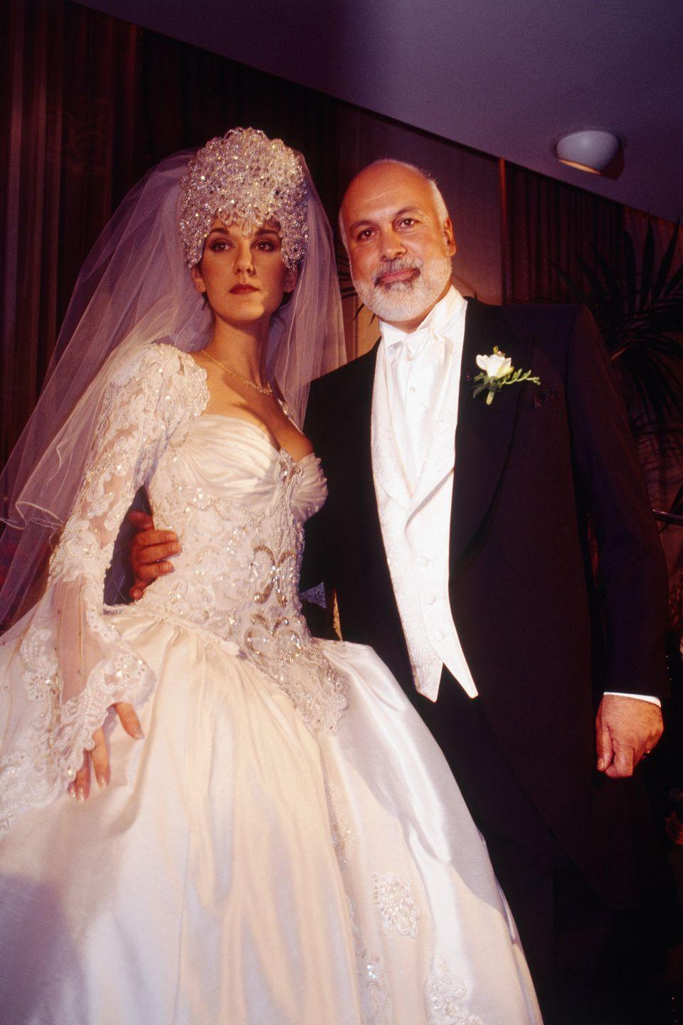 "<p>The iconic singer kicked off her marriage to her <a href=""https://www.goodhousekeeping.com/life/relationships/g3070/celine-dion-rene-angelil-romance/"" rel=""nofollow noopener"" target=""_blank"" data-ylk=""slk:manager Rene Angélil"" class=""link rapid-noclick-resp"">manager Rene Angélil</a> on December 17, 1994 wearing a breathtaking Mirella and Steve Gentile gown featuring long sleeves and a 20-foot train. The (literal) crowning glory of the look that's more divisive than the dress itself: a seven-pound headpiece.</p>"