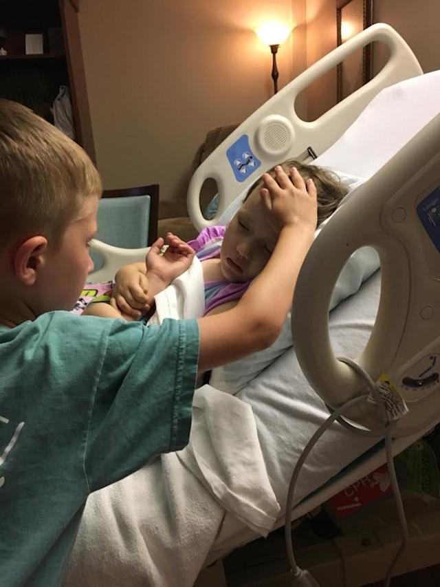 A photo of a boy by the bedside of his dying 4-year-old sister is going viral. (Photo: Hope for Addy Joy – Fighting DIPG via Facebook)