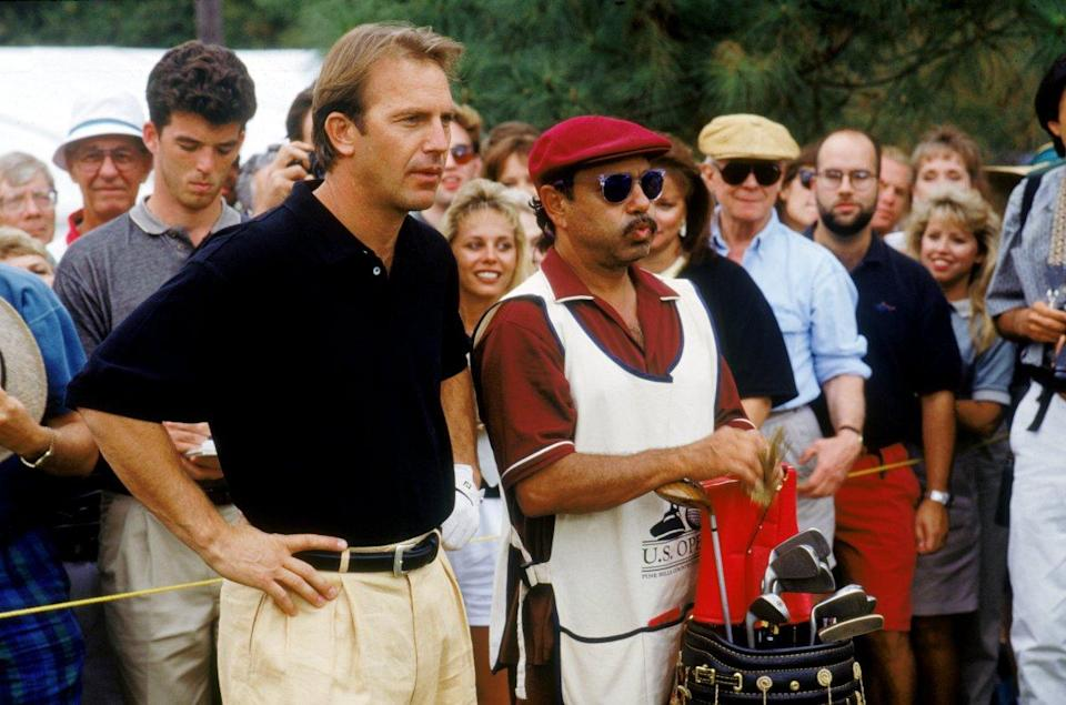 Kevin Costner gets ready to golf (Warner Brothers).