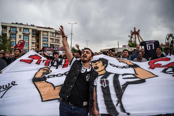 <p>Supporters of the Besiktas football club chant slogans as they gather in Bakirkoy district as part of the the May Day rally, in Istanbul, on May 1, 2017. (Ozan Kose/AFP/Getty Images) </p>