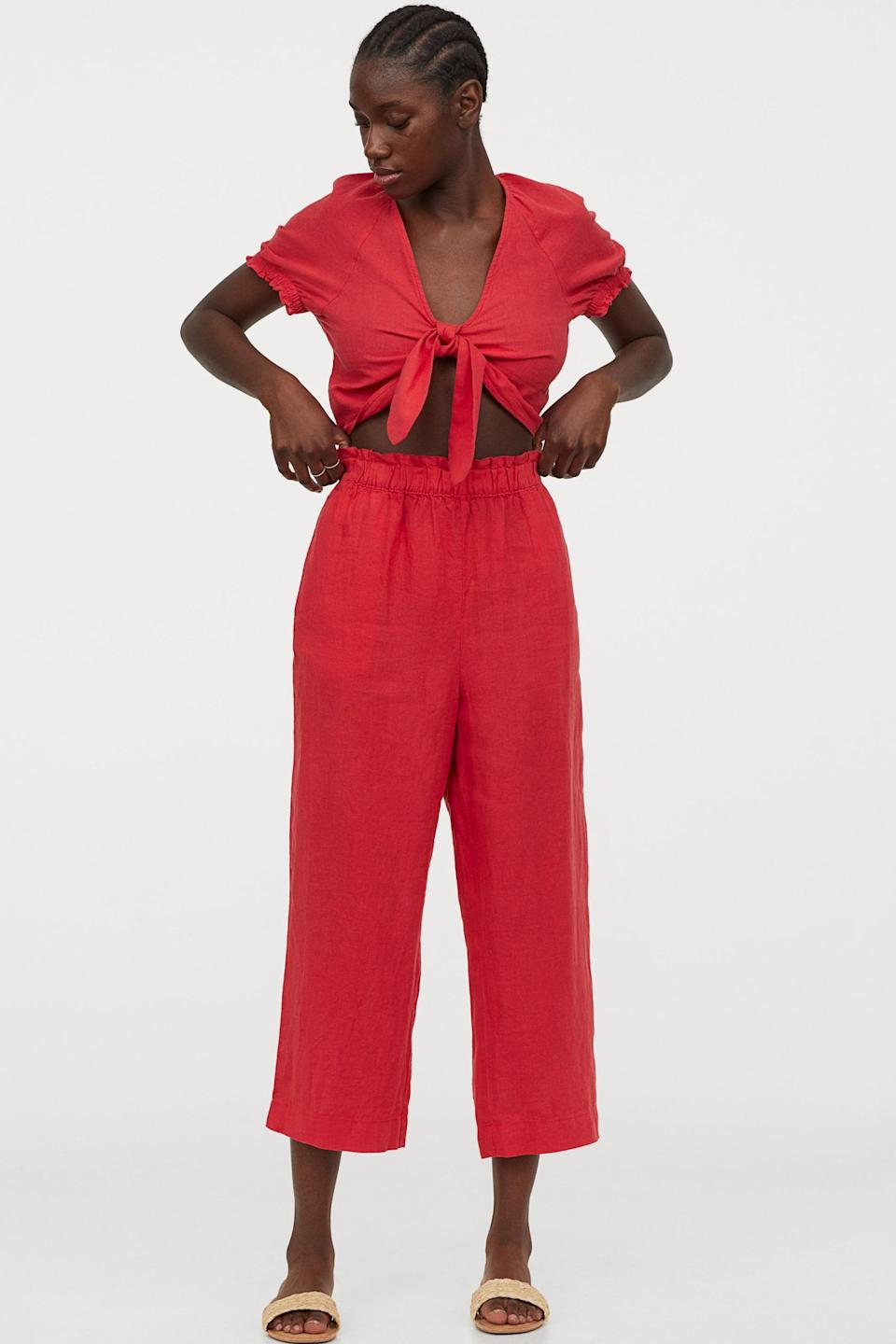 <p>Add a pop of color to your wardrobe with these red <span>H&M Linen Culottes</span> ($35).</p>