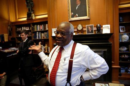 FILE PHOTO: U.S. Supreme Court Justice Thomas talks in his chambers at the U.S. Supreme Court building in Washington