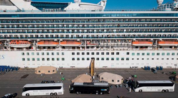 PHOTO: Medical Personnel help load passengers onto busses as they are disembarked from the Grand Princess cruise ship at the Port of Oakland in Oakland, Calif., March 10, 2020. (Josh Edelson/AFP via Getty Images, FILE)