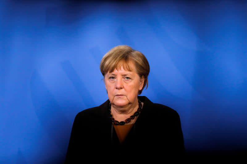 FILE PHOTO: FILE PHOTO: German Chancellor Angela Merkel briefs the media after a virtual meeting with federal state governors at the chancellery in Berlin