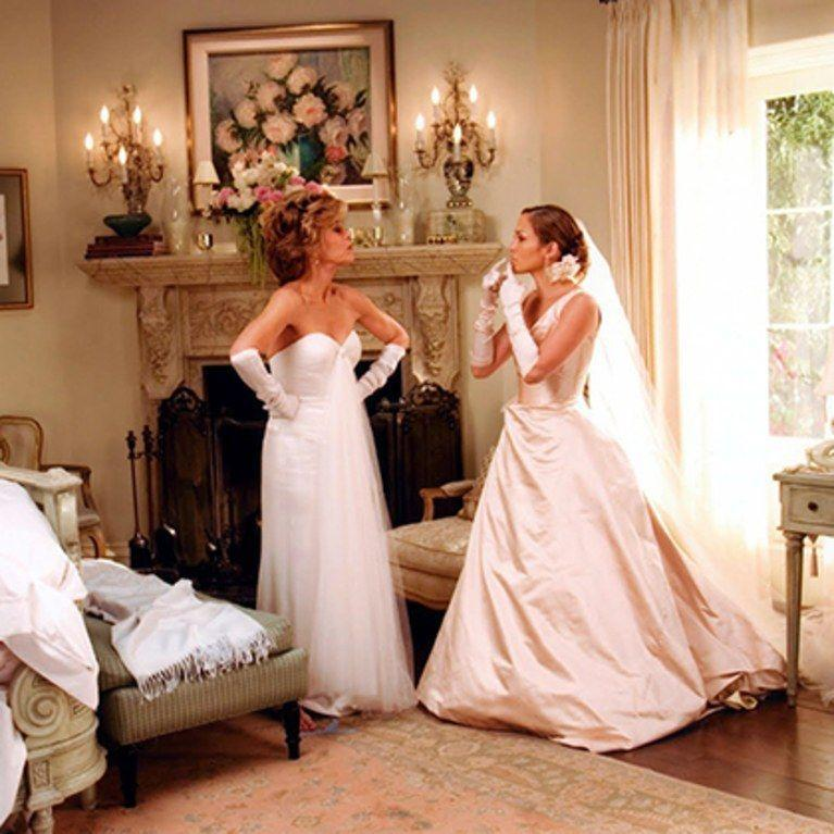 <p>While the idea of a wife-to-be and her future husband's mother duking it out for his affection is very 🙄, one thing that <em>is</em> great about this movie is J. Lo's wedding dress, complete with elbow-length gloves because why not?<br></p>