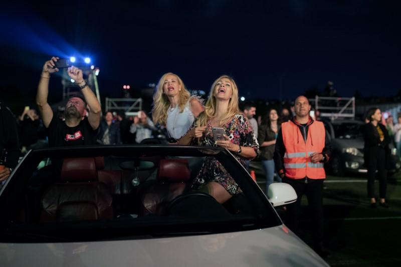 Social-distancing Greek style: shimmy and sing from your car
