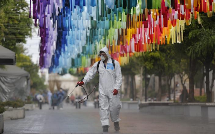 Workers carry out disinfection and cleaning work in public areas in the municipality of Zapopan, in Jalisco, Mexico - Francisco Guasco/EPA-EFE/Shutterstock