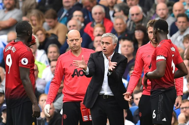 Romelu Lukaku (left) and Paul Pogba (right) have been routinely dropped by Jose Mourinho (centre) this season