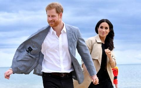 The Duke and Duchess of Sussex on South Melbourne Beach on Thursday - Credit: Tim Rooke/Rex