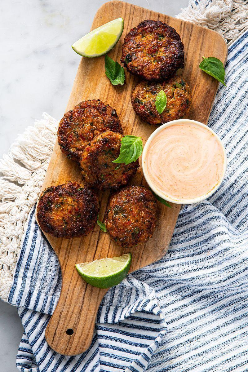 """<p>These <a href=""""https://www.delish.com/uk/cooking/recipes/g30761979/thai-food/"""" rel=""""nofollow noopener"""" target=""""_blank"""" data-ylk=""""slk:Thai"""" class=""""link rapid-noclick-resp"""">Thai</a> Fish Cakes are incredibly delicious. Seasoned beautifully and topped with <a href=""""https://www.delish.com/uk/cooking/recipes/a28756634/garlic-sriracha-pork-stir-fry-recipe/"""" rel=""""nofollow noopener"""" target=""""_blank"""" data-ylk=""""slk:sriracha"""" class=""""link rapid-noclick-resp"""">sriracha</a> mayo, you're going to want to eat these on the regular. </p><p>Get the <a href=""""https://www.delish.com/uk/cooking/recipes/a30622495/thai-fish-cakes/"""" rel=""""nofollow noopener"""" target=""""_blank"""" data-ylk=""""slk:Thai Fish Cakes With Sriracha Mayo"""" class=""""link rapid-noclick-resp"""">Thai Fish Cakes With Sriracha Mayo</a> recipe.</p>"""