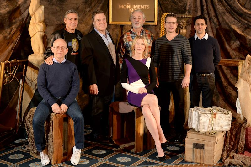 """In this Thursday, Jan. 16, 2014 photo, from left, actor Bob Balaban, director, screenwriter and actor, George Clooney, actor John Goodman, actor Bill Murray, actress Cate Blanchett, actor Matt Damon and screenwriter Grant Heslov pose during a photocall for """"The Monuments Men"""" at the Four Seasons Hotel, in Los Angeles. The World War II drama opens Friday, Feb 7, 2014. Based on a true story, the film is adapted from Robert Edsel's book, """"The Monuments Men: Allied Heroes, Nazi Thieves and the Greatest Treasure Hunt in History."""" (Photo by Jordan Strauss/Invision/AP)"""