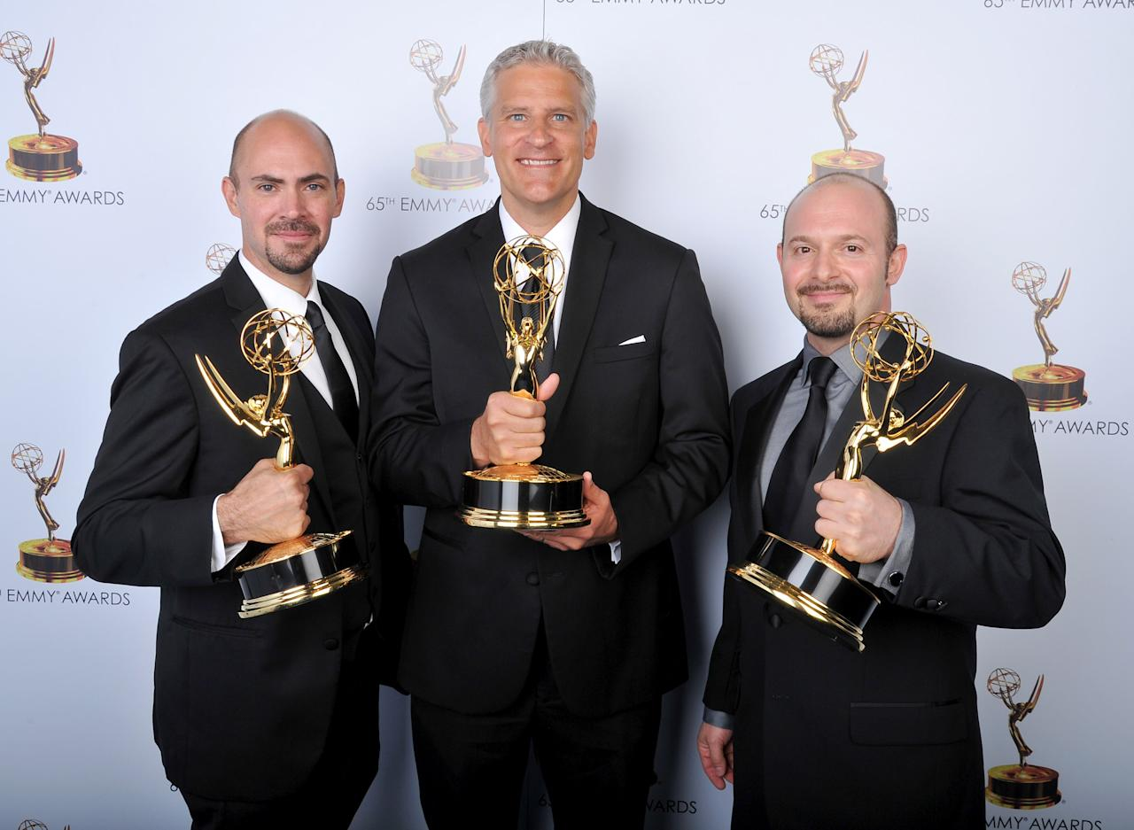 From left, Steve Kelley, Todd Kleitsch, Jamie Kelman pose for a portrait at the 2013 Primetime Creative Arts Emmy Awards, on Sunday, September 15, 2013 at Nokia Theatre L.A. Live, in Los Angeles, Calif. (Photo by Vince Bucci/Invision for Academy of Television Arts & Sciences/AP Images)