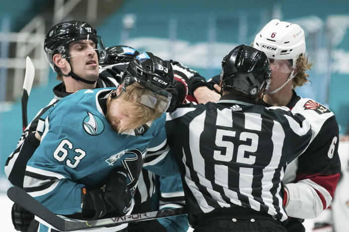 San Jose Sharks left wing Jeffrey Viel (63) and Arizona Coyotes defenseman Jakob Chychrun (6) fight during the first period of an NHL hockey game in San Jose, Calif., Saturday, May 8, 2021. (AP Photo/John Hefti)