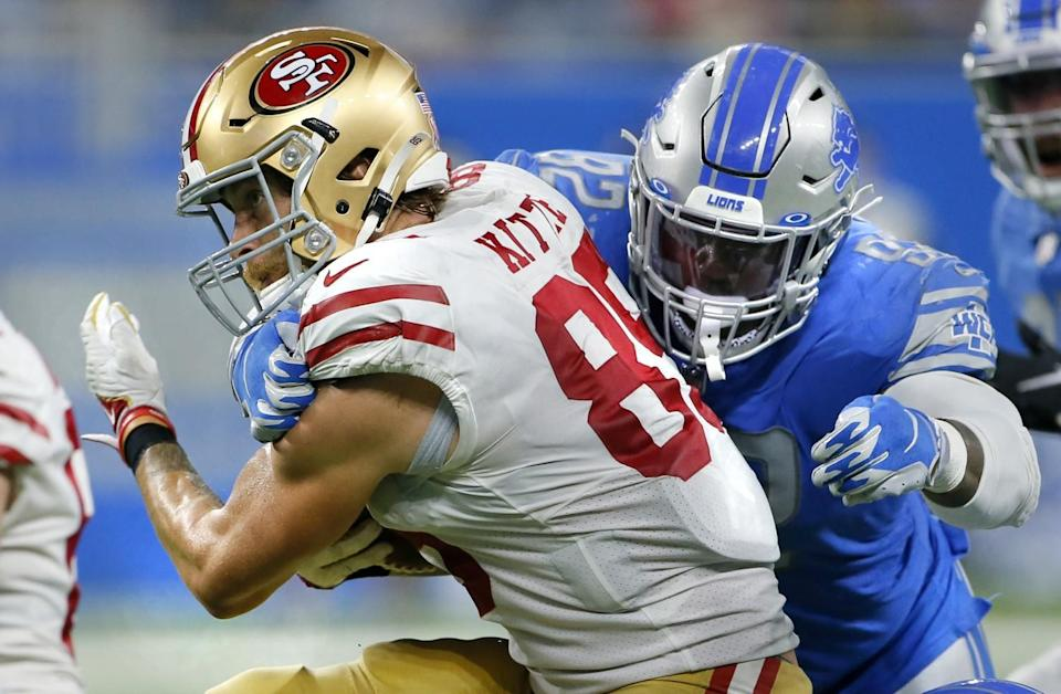 Detroit Lions defensive tackle Kevin Strong tackles San Francisco 49ers tight end George Kittle.