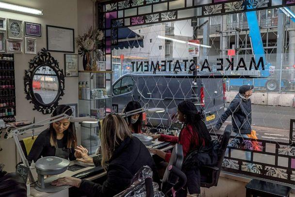 PHOTO: Women work in a Vietnamese-owned nail salon in the Tottenham district of London on Dec. 16, 2017. (The New York Times via Redux, FILE)