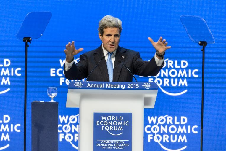 US Secretary of State John Kerry gestures during a speech at the World Economic Forum annual meeting in Davos on January 23, 2015 (AFP Photo/Fabrice Coffrini)