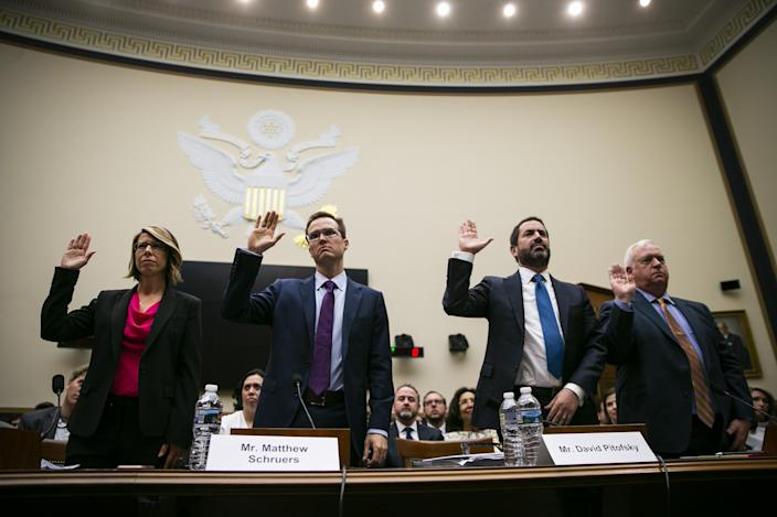 From left, Sally Hubbard, director of enforcement strategy at Open Markets Institute, from left, Matthew Schruers, vice president of law and policy at the Computer and Communications Industry Association, David Pitofsky, general counsel with News Corp., and Kevin Riley, editor at the Atlanta-Journal Constitution, are sworn in during a House Judiciary Subcommittee hearing in Washington, D.C., U.S., on Tuesday, June 11, 2019.  (Al Drago/Bloomberg via Getty Images)